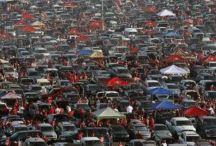 Fans tailgate before the San Francisco 49ers play the Atlanta Falcons during a Monday Night Football game which will be the last regular season game to be held at Candlestick Park in San Francisco, CA, Monday, December 23, 2013.