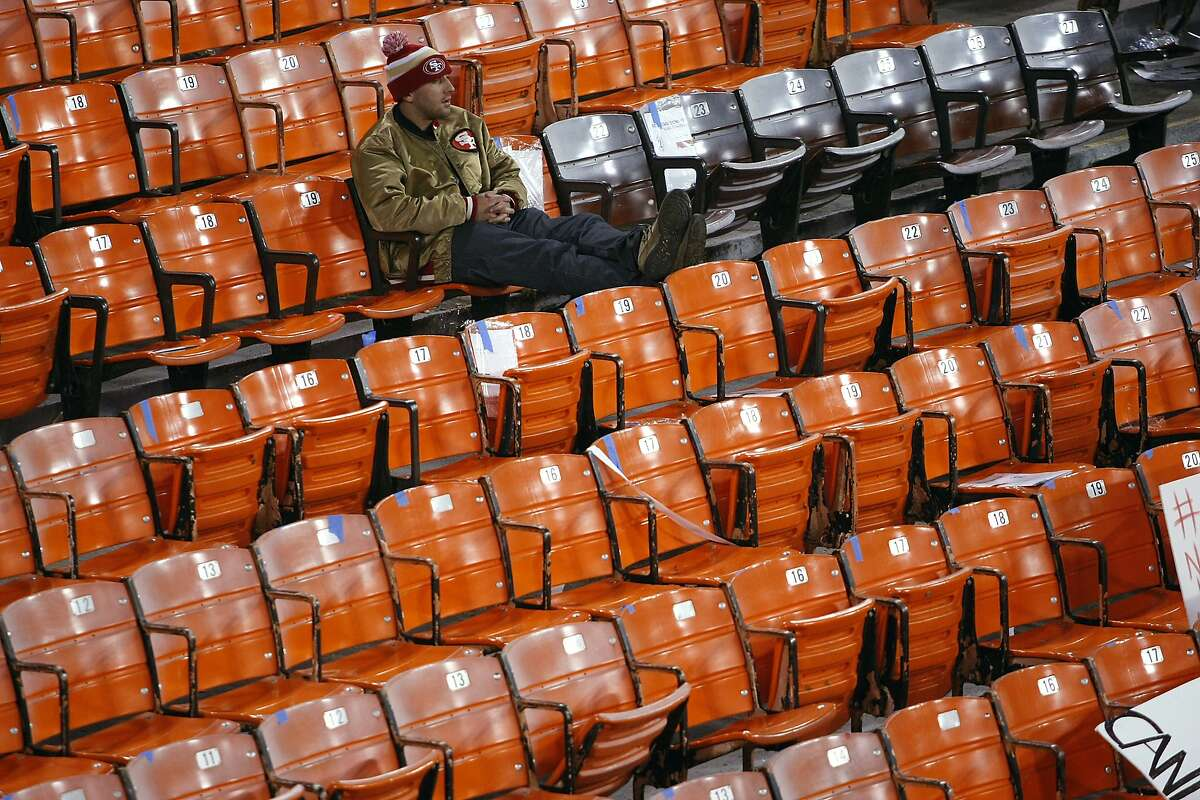 Rael Enteen of San Francisco sits by himself in the stands after the San Francisco 49ers defeated the Atlanta Falcons during a Monday Night Football game which will be the last regular season game to be held at Candlestick Park in San Francisco, CA, Monday, December 23, 2013.
