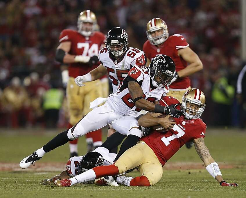 iSan Francisco 49ers quarterback Colin Kaepernick (7) is tackled by Atlanta Falcons cornerback Robert Alford (23) during the third quarter of the game between the San Francisco 49ers and Atlanta Falcons at Candlestick Park on Monday December 23, 2013 in San Francisco, Calif. Photo: Michael Macor, The Chronicle