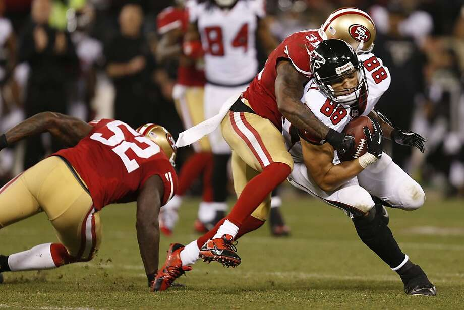 Atlanta Falcons tight end Tony Gonzalez (88) is tackled by San Francisco 49ers safety Donte Whitner (31) during the fourth quarter of the game between the San Francisco 49ers and Atlanta Falcons at Candlestick Park on Monday December 23, 2013 in San Francisco, Calif. Photo: Michael Macor, The Chronicle