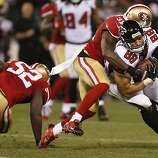 Atlanta Falcons tight end Tony Gonzalez (88) is tackled by San Francisco 49ers safety Donte Whitner (31) during the fourth quarter of the game between the San Francisco 49ers and Atlanta Falcons at Candlestick Park on Monday December 23, 2013 in San Francisco, Calif.
