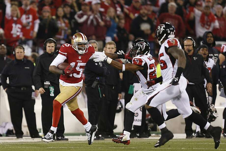 San Francisco 49ers wide receiver Michael Crabtree (15) evades defenders as he gains forty-seven yards on a reception during the third quarter of the game between the San Francisco 49ers and Atlanta Falcons at Candlestick Park on Monday December 23, 2013 in San Francisco, Calif. Photo: Michael Macor, The Chronicle