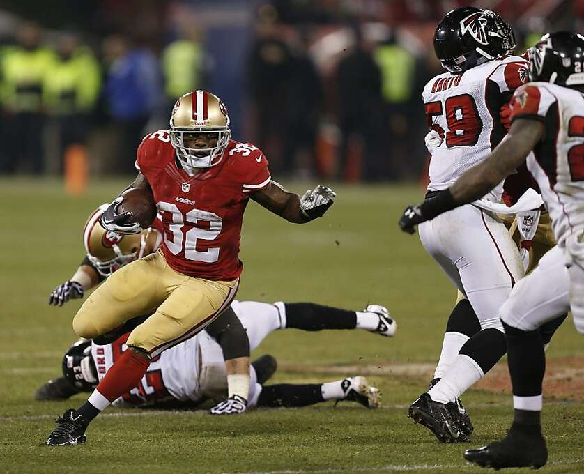 San Francisco 49ers running back Kendall Hunter (32) gains forty-five yards on a key run during the fourth quarter of the game between the San Francisco 49ers and Atlanta Falcons at Candlestick Park on Monday December 23, 2013 in San Francisco, Calif. Photo: Michael Macor, The Chronicle