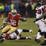 San Francisco 49ers running back Kendall Hunter (32) gains forty-five yards on a key run during the fourth quarter of the game between the San Francisco 49ers and Atlanta Falcons at Candlestick Park on Monday December 23, 2013 in San Francisco, Calif.