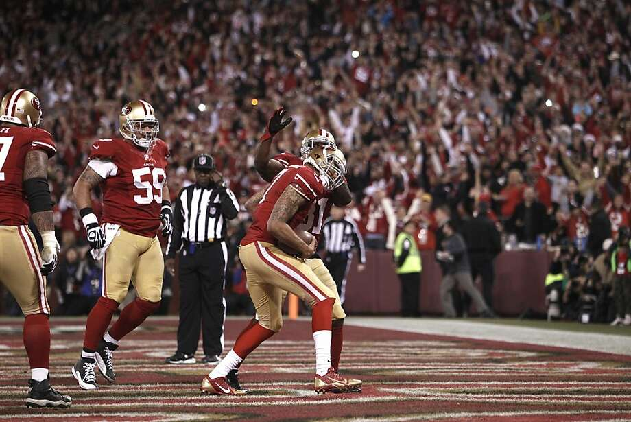 San Francisco 49ers quarterback Colin Kaepernick (7) celebrates after scoring a touchdown on a four yard run during the fourth quarter of the game between the San Francisco 49ers and Atlanta Falcons at Candlestick Park on Monday December 23, 2013 in San Francisco, Calif. Photo: Michael Macor, The Chronicle