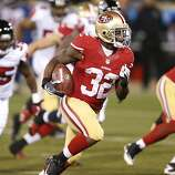 San Francisco 49ers running back Kendall Hunter (32) during a run in the second quarter of the game between the San Francisco 49ers and Atlanta Falcons at Candlestick Park on Monday December 23, 2013 in San Francisco, Calif.