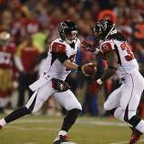 Atlanta Falcons quarterback Matt Ryan (2) hands off to Steven Jackson during the first quarter in Monday night's game at Candlestick Park on Dec. 23, 2013 in San Francisco, Calif.