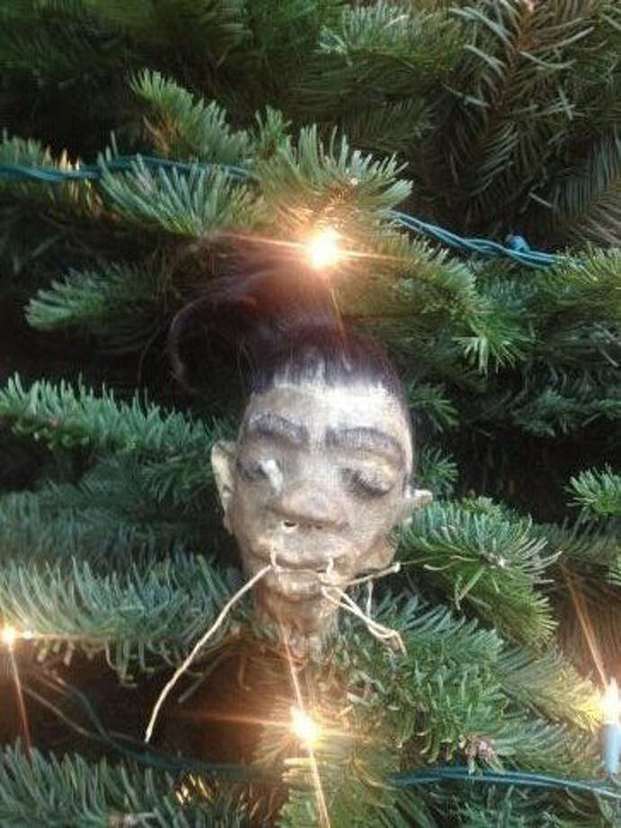 Lynn S. Freeman, Katy:  My father got this shrunken head (cow hide) from Latin. America many years ago. Against my mother's wishes. He hung it on the Christmas tree. He passed away in 1996. And I continued to hang it in a place of honor, and in memory of his sense of humor. Those of you who know Dr. Steele from Angleton will know how appropriate it is.