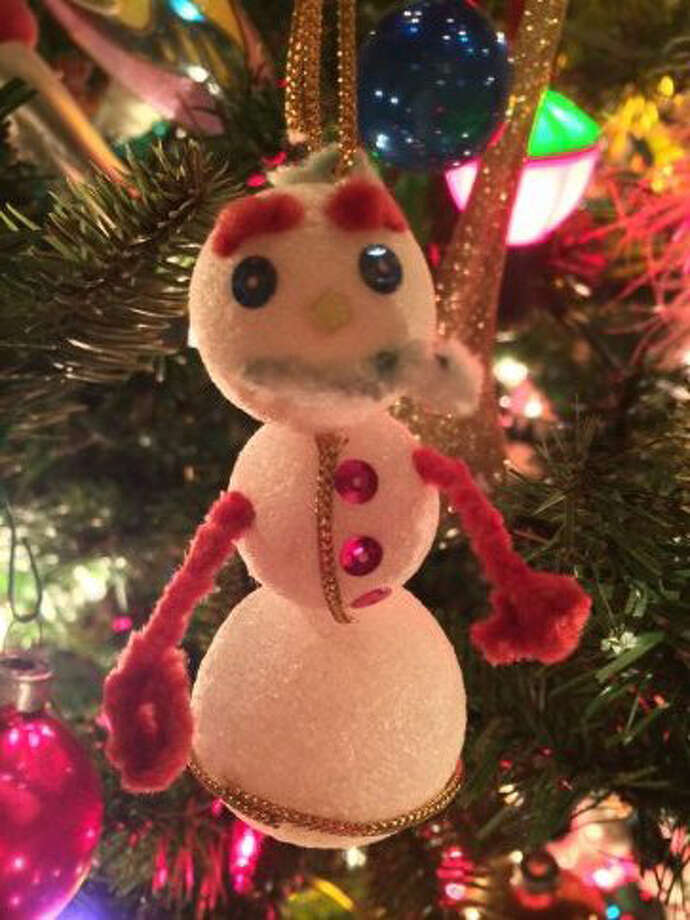 Cynthia Rose, Houston:Mr. Frosty was created in 1964 at the dining room table of my beloved mother Mary Jean  in Oklahoma City.  Mother was crafting beautiful custom ornaments for our Christmas tree with all sorts of shiny beads, sequins, baubles, rhinestones, paint and odds n'ends.  It was fascinating to watch the marvelous creations of her hand emerge each day for addition to our tree.  She invited and encouraged me to join her and craft a one of a kind masterpiece to add to the collection, giving me full creative reign.  Thus, Mr. Frosty was born.  Mother lovingly told me he was perfect and he was added to her collection where he proudly hung for 40 years beside her beautiful ornaments as if he were one of them.  When Mom went to her eternal reward in heaven, Mr. Frosty came to live with us in Houston.  Every year, when he is added to our tree, I am sweetly reminded of my wonderful  Mother's unconditional love.