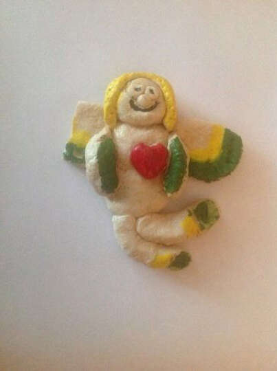 Ephron Catlin, Houston: Created by my daughter 37 years ago, this dough ornament angel was the sole