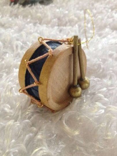 Ina McDonald: This tiny wooden drum graced my parent's first Christmas tree after they married dur