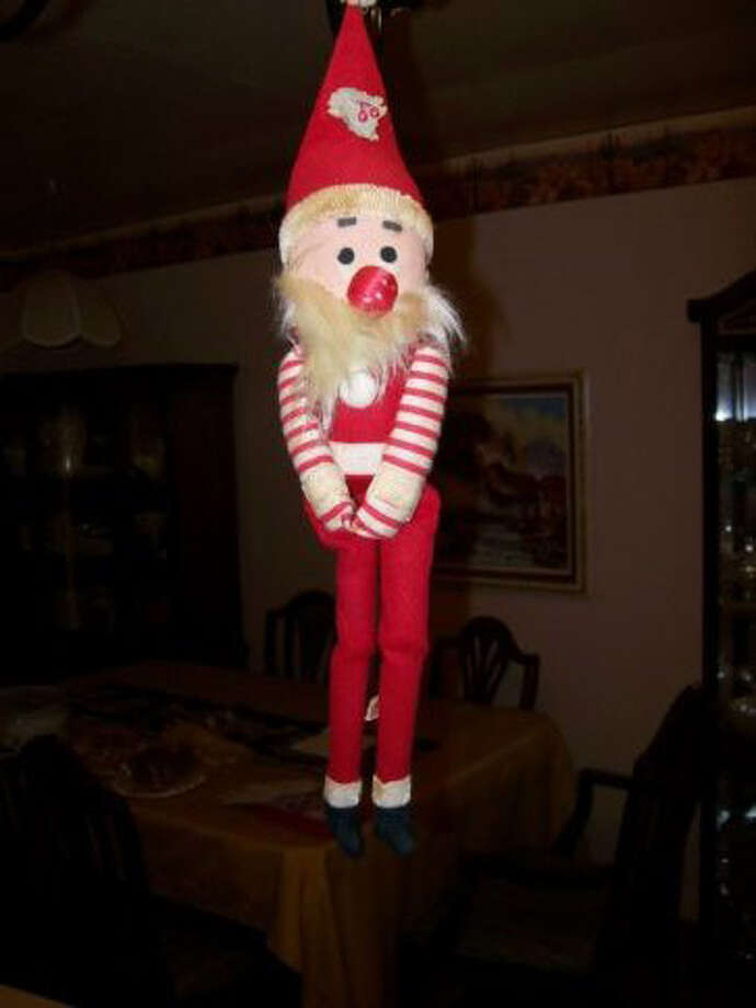 Jeannine Coleman, Humble: Christmas week in l970 my husband, Hays Coleman, had a stomach virus and his chest started hurting and he was sent to St. Joseph's hospital and was in CCU for 3 days.  On Christmas Eve he was declared okay and sent to a room.  We found this little Christmas object on a box of candy and used it to help decorate his room.  Every year now we hang him from a light in our living room to remember that God is good. Hays celebrated his 87th birthday this Dec. 3rd.
