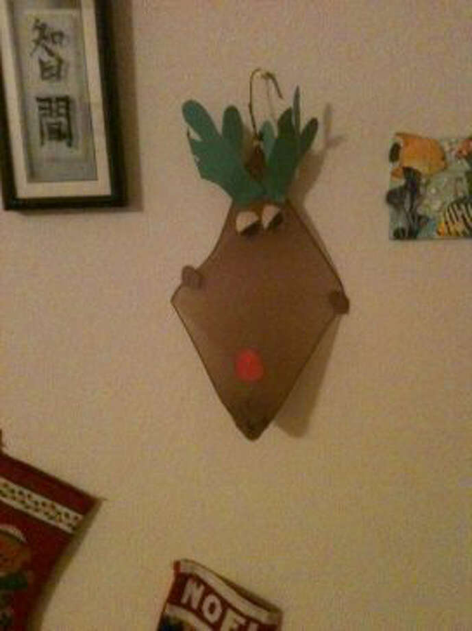 Mary Peldo, Houston: My daughter made this when she was in the fifth grade. It is the leg of a pair of hose stretched over a bent coat hanger. She is now 21. I have hung this reindeer every year. It really stands out in the room!