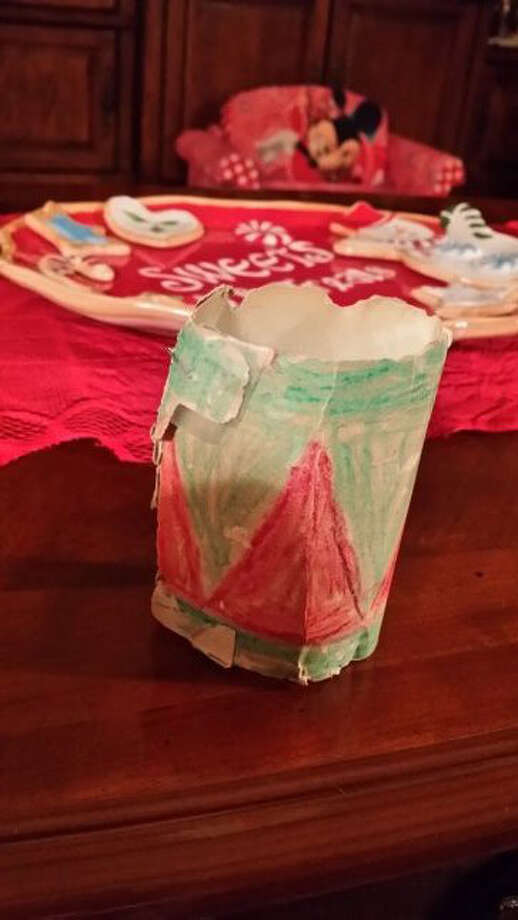 Sharon Pendley, Sugar Land: My son Scott made this little paper drum when he was in the first grade in 1978. I was room mother in his class & I can remember every detail of him coloring  & trying to paste it together. Its tattered & torn but I still hang it every year on my tree as a remembrance to him as he was killed almost 17 years ago.