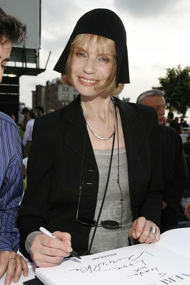 Verushka autographs her new book on September 5, 2008 in New York City. Vuruschka was born in 1939. Photo: Mark Von Holden, WireImage