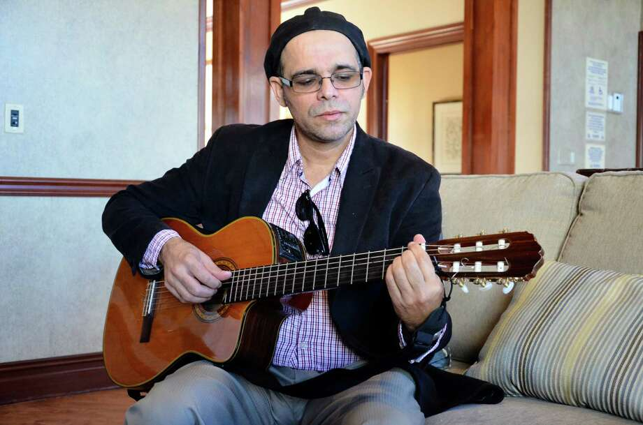 Brazilian jazz musician Nanny Assis plays his acoustic guitar at the Avalon clubhouse in New Canaan, Conn. The Brazilian International Press Awards has nominated Assis for best musician and best male performer in the United States. He won as best male performer in 2011. Photo: Nelson Oliveira / New Canaan News
