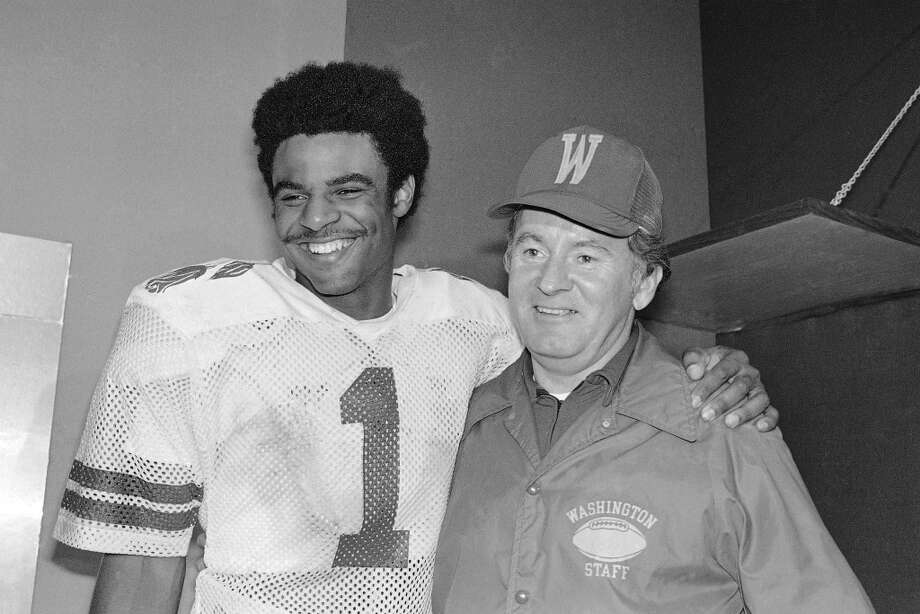 Don James Dec. 31, 1932 – Oct. 20, 2013The former Washington football coach, shown here with Warren Moon, led the Huskies to a share of the national championship in 1991. James was 176-78-3 at Kent State and Washington, going 153-58-2 in 18 seasons with the Huskies from 1975-92. His 1991 team topped the coaches' poll, while Miami was the national champion in The Associated Press' media poll. James was inducted into the College Football Hall of Fame as a coach in 1997. Photo: Anonymous, Associated Press