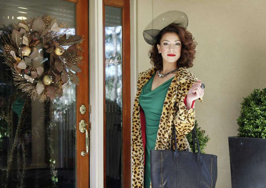 Ralph Lauren's emerald green dress is accented with a leopard print coat,  black tote and horsehair-brimmed headpiece. Photo: Photos By Michael S. Wirtz / Philadelphia Inquirer / Philadelphia Inquirer
