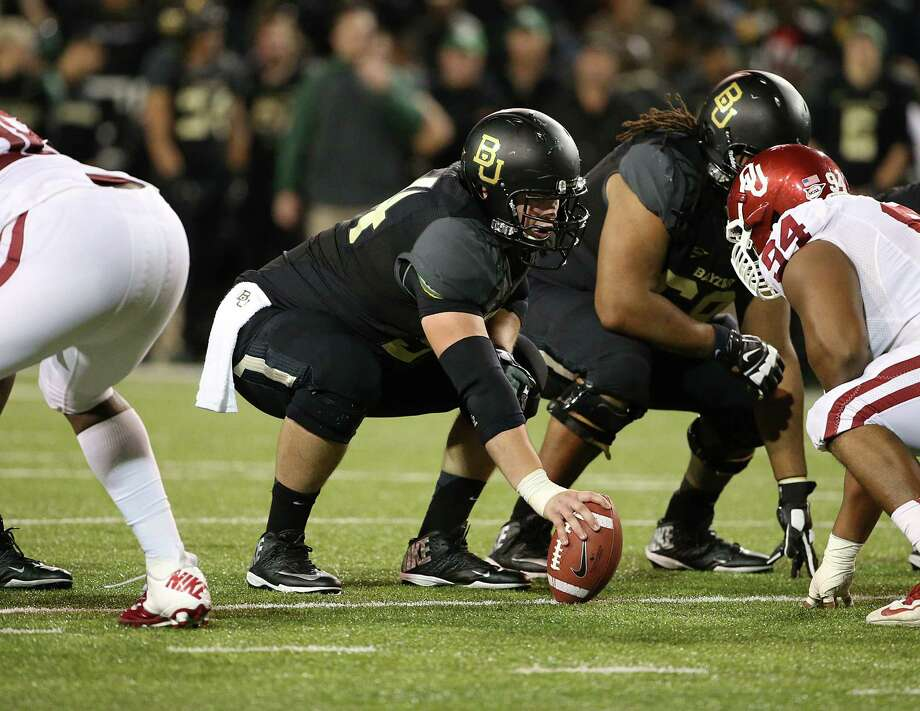 After suffering through seasons shortened by injuries, former Nederland star Stephan Huber became a starter this season at center for the Baylor Bears. Huber helped the team win its first Big 12 championship and earn a berth in the Fiesta Bowl.  Photo provided by Baylor University Photo: Robert Rogers / Copyright © 2013 Baylor University - All Rights Reserved