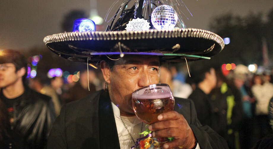Frank Sanchez drinks a beer during last year's Celebrate San Antonio. The annual event of the San Antonio Parks and Recreation Department begins at 6 p.m. Tuesday, Dec. 31. Photo: Edward A. Ornelas / San Antonio Express-News / © 2012 San Antonio Express-News