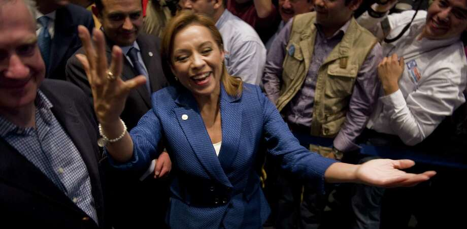 Josefina Vázquez Mota, seen celebrating her victory as National Action Party presidential candidate, hopes her new book will inspire Mexico's leaders to fix the country's economic problems. Photo: ALFREDO ESTRELLA, AFP/Getty Images / ALFREDO ESTRELLA