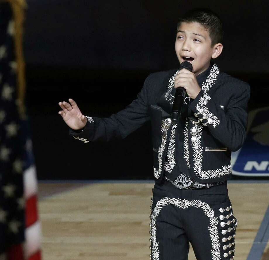 Sebastien De la Cruz sings the national anthem before Game 4 of the NBA Finals basketball series between the Spurs and the  Heat. His critics were put in their place. Photo: David J. Phillip / Associated Press / AP