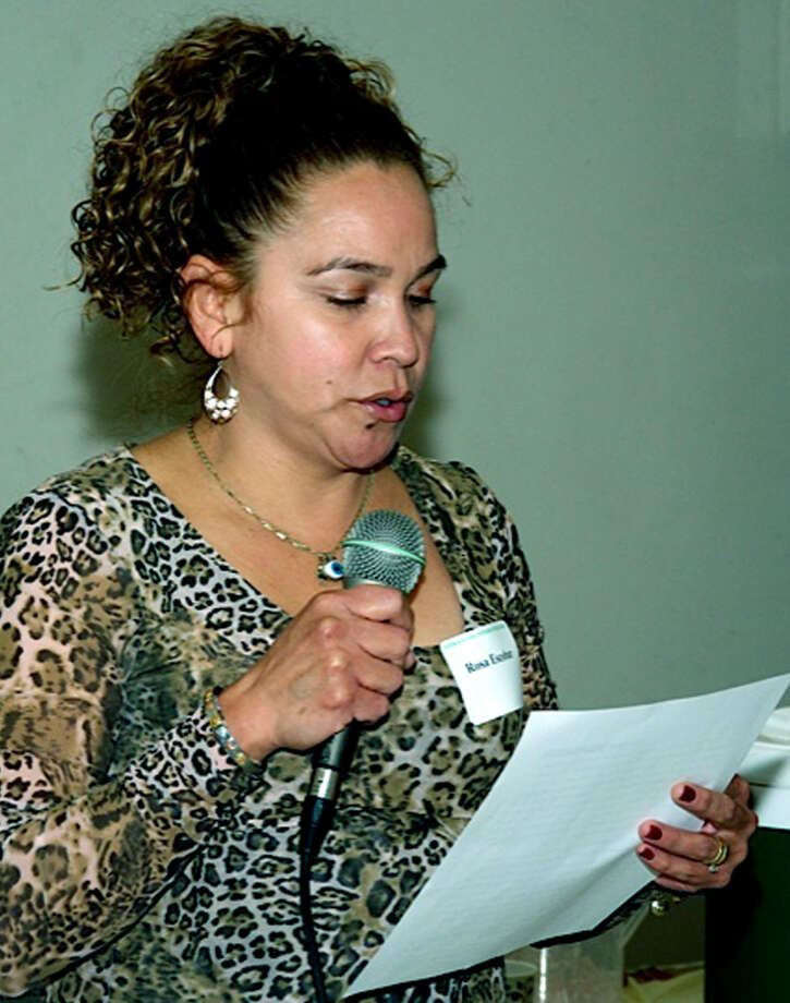 Student Rosa Escobar shares her thoughts during Literacy Volunteers on the Green's Nov. 20, 2013 recognition dinner at St. John's Episcopal Church in New Milford.  Courtesy of Literacy Volunteers on the Green Photo: Norm Cummings / The News-Times
