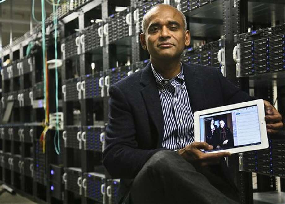 In this Thursday, Dec. 20, 2012, file photo, Chet Kanojia, founder and CEO of Aereo, shows a tablet displaying his company's technology, in New York. Aereo is one of several startups created to deliver traditional media over the Internet without licensing agreements. Photo: Bebeto Matthews, AP / Associated Press contributed