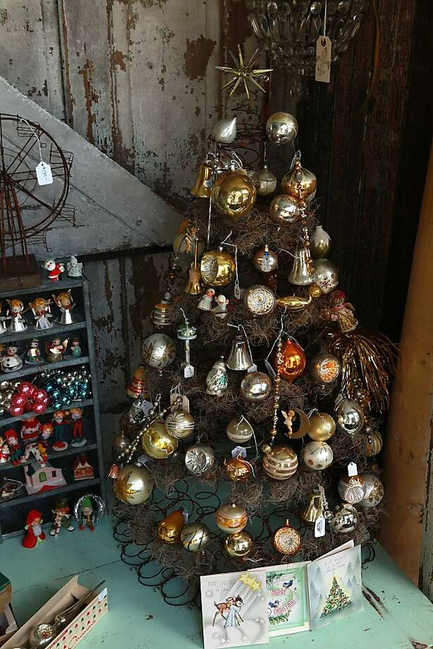 A Christmas tree made out of box springs and moss decorated with ornaments from mainly Japan, USA, and west Germany from the 1930's to 1950's displayed at Dream in San Mateo, California, on Thursday, October 10, 2013. Photo: Liz Hafalia, The Chronicle