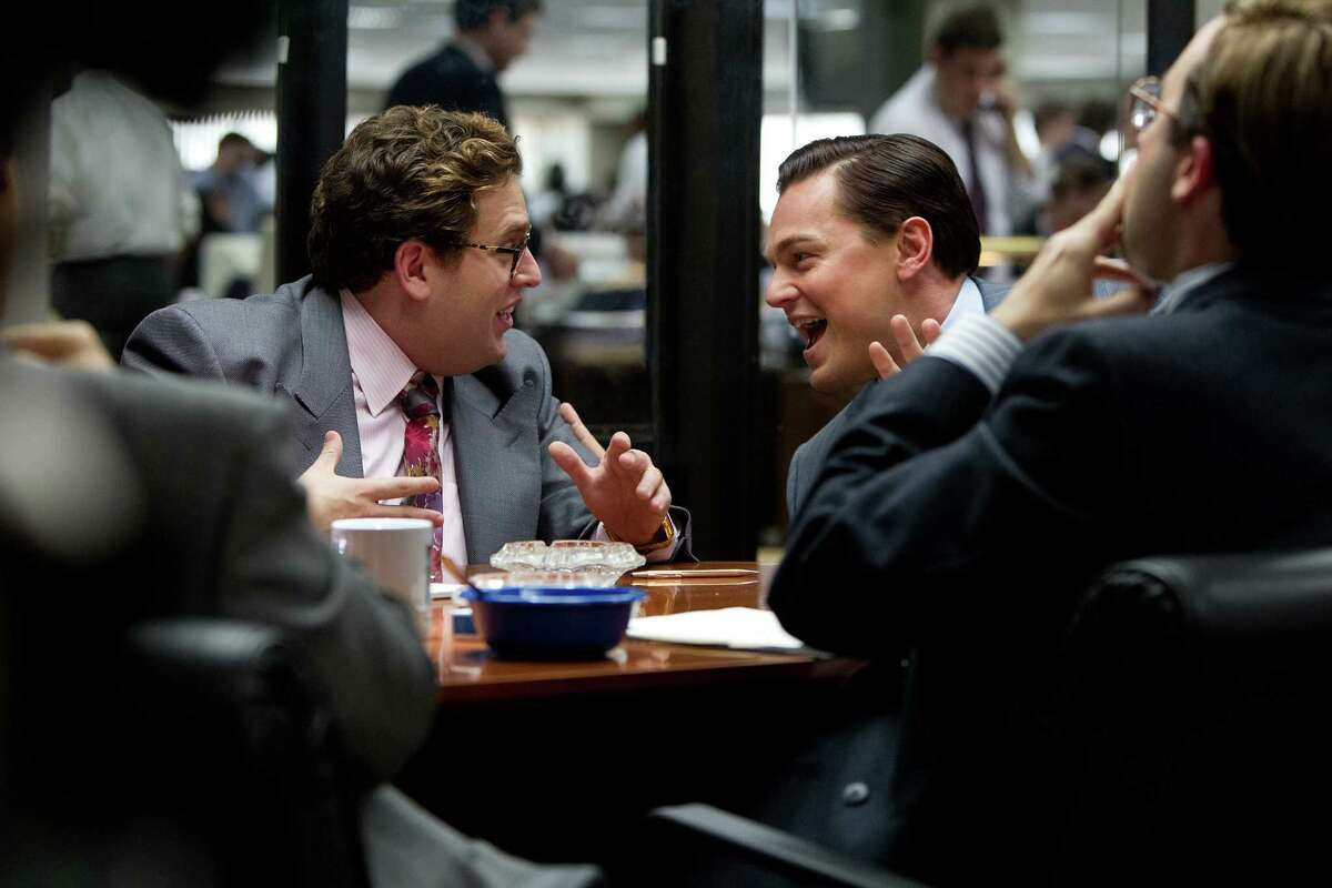 Left to right: Jonah Hill is Donnie Azoff and Leonardo DiCaprio is Jordan Belfort in THE WOLF OF WALL STREET,