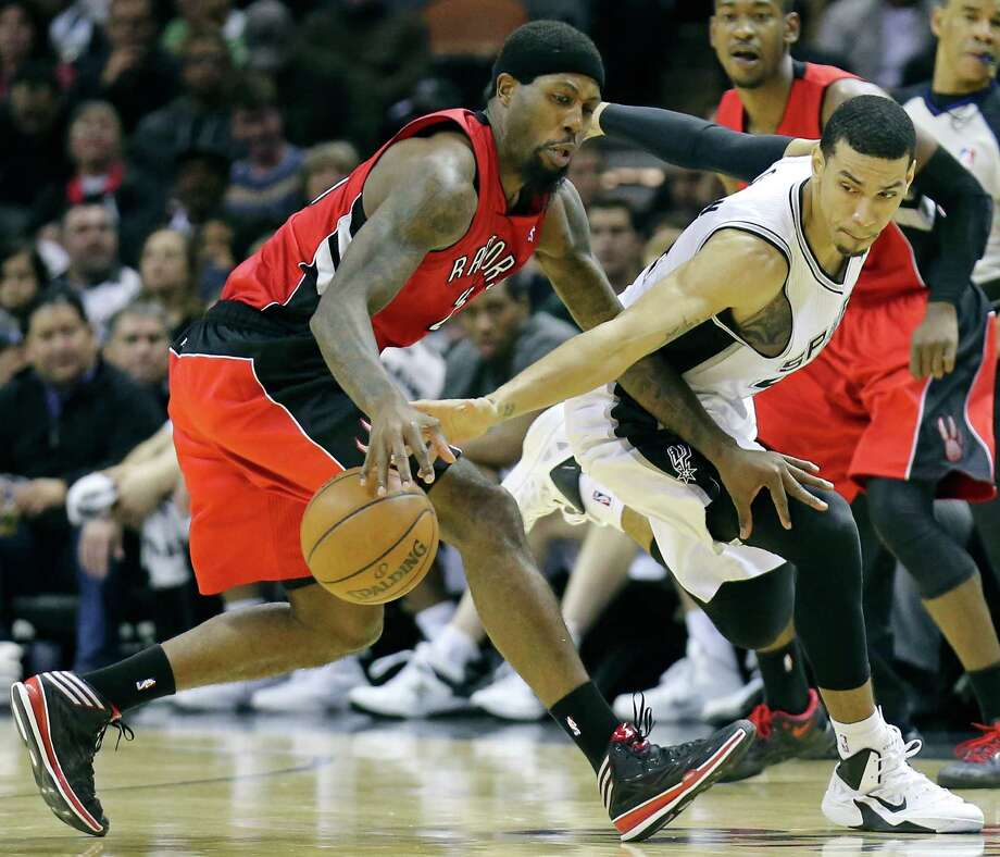 Toronto Raptors' John Salmons and San Antonio Spurs' Danny Green chase after a loose ball during second half action Monday Dec. 23, 2013 at the AT&T Center. The Spurs won 112-99. Photo: Edward A. Ornelas, San Antonio Express-News / © 2013 San Antonio Express-News