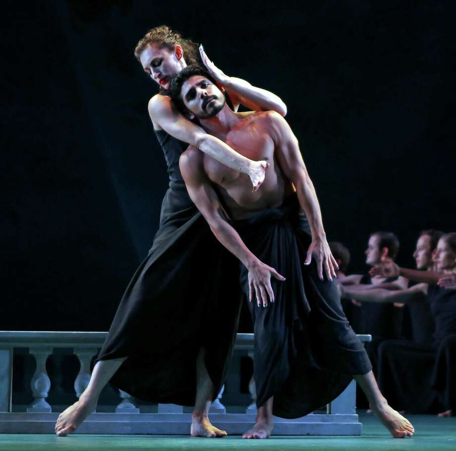 """Amber Star Merkens, left, and Domingo Estrada Jr. performing in """"Dido and Aeneas"""" at the Mostly Mozart Festival at the Rose Theater in New York, Aug. 22, 2012. In the revival of Mark Morris' version of """"Dido and Aeneas,"""" the Sorceress and Dido are danced, for the first time in New York, by a single woman. (Andrea Mohin/The New York Times) Photo: ANDREA MOHIN / NYTNS"""