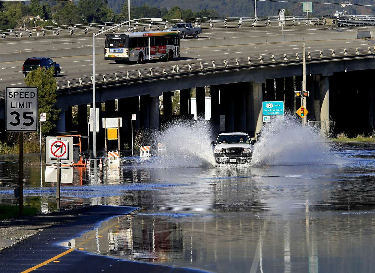 A truck drives through flooding from bay waters at a Highway 1 off ramp in Marin County, Calif. on Wednesday, Dec. 12, 2012. Highway 101 is in background. Forecasters are urging people enjoying the Northern California coast to be careful as high tides and big waves hit the region's beaches during the next few days. The National Weather Service says so-called King Tides - caused by a rather unique combination of how the sun, the moon and the earth align - will bring the highest tides of the year on Thursday, Friday and Saturday mornings. (AP Photo/San Francisco Chronicle, Brant Ward) NORTHERN CALIFORNIA MANDATORY CREDIT PHOTOG & CHRONICLE; MAGS OUT; NO SALES;