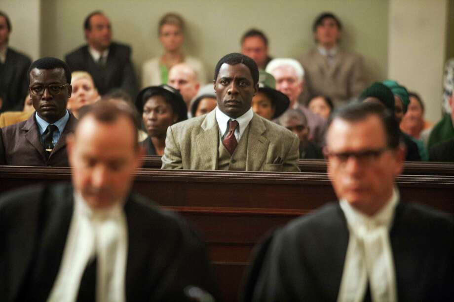 """The struggle and triumph of Nelson Mandela (played by Idris Elba, center) is portrayed in the enlightening """"Mandela: Long Walk to Freedom."""" Photo: The Weinstein Co. / The Weinstein Company"""