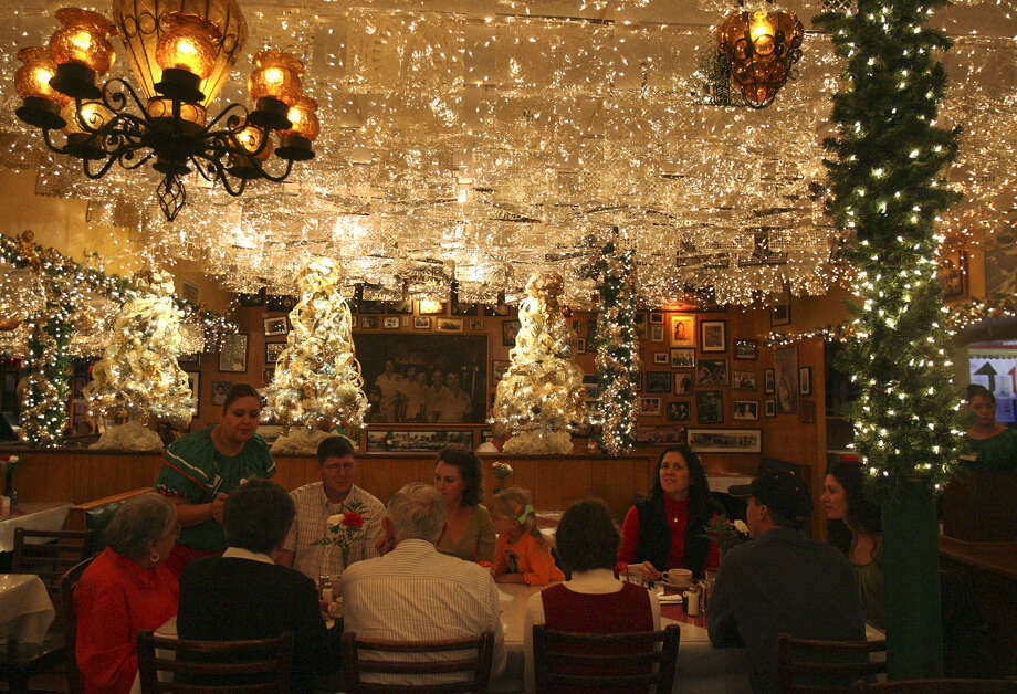 Patrons of Mi Tierra Restaurant prepare to dine. The restaurant steps up its year-round Christmas decorations for the holiday season. Photo: Express-News File Photo / jdavenport@express-news.net
