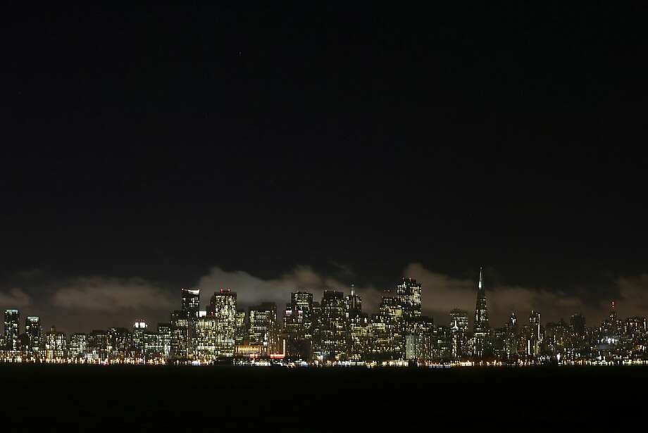The San Francisco skyline at night, Sept. 9, 2013. As the epicenter of the technology industry has moved north from Silicon Valley to San Francisco, income disparities have widened sharply and housing prices have soared, causing resentment among longtime residents. (Jim Wilson/The New York Times) Photo: Jim Wilson, New York Times