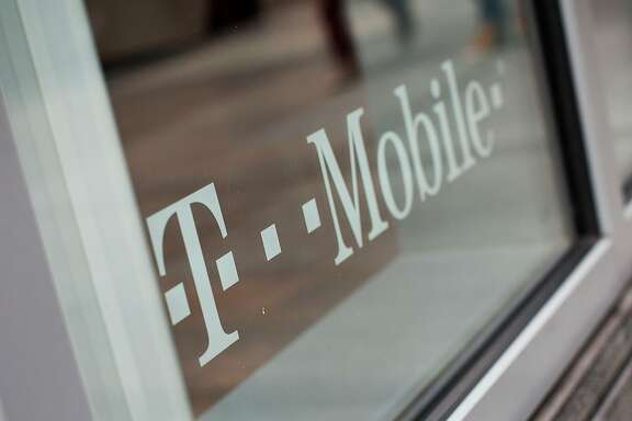 FILE - DECEMBER 13:  According to reports December 13, 2013, The third largest cellphone U.S. carrier Sprint is working on a possible merger with fourth largest cellphone carrier T-Mobile.  NEW YORK, NY - MARCH 23:  A T-Mobile store is seen at 7th Avenue and 49th Street on March 23, 2012 in New York City. T-Mobile USA announced they would be eliminating 1,900 call-center jobs in an effort to cut costs.  (Photo by Andrew Burton/Getty Images)