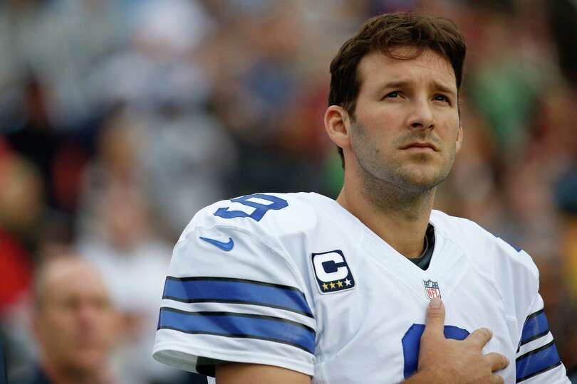 Dallas Cowboys quarterback Tony Romo stands on the sidelines during the National Anthem before an NF