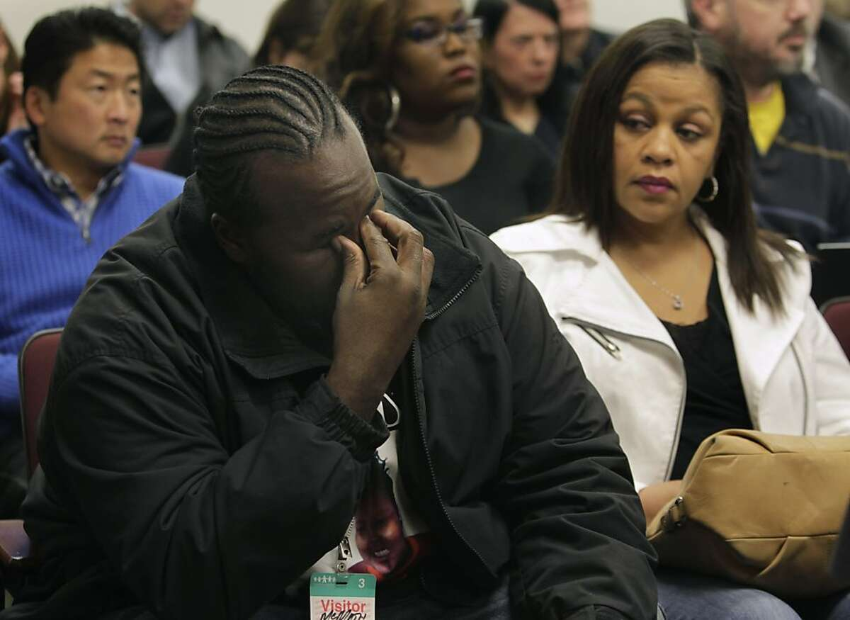 Martin Winkfield, stepfather of Jahi McMath, reacts to testimony at a hearing in Alameda County Superior Court to determine the condition of the 13-year-old in Oakland, Calif. on Tuesday, Dec. 24, 2013. At right is Jahi's grandmother Sandra Chatman. McMath was determined to be clinically brain dead following complications from a routine tonsillectomy at Children's Hospital in Oakland. Dr. Paul Fisher, chief of pediatric neurology at Lucile Packard Children's Hospital, concluded that Jahi meets all the criteria of brain death.