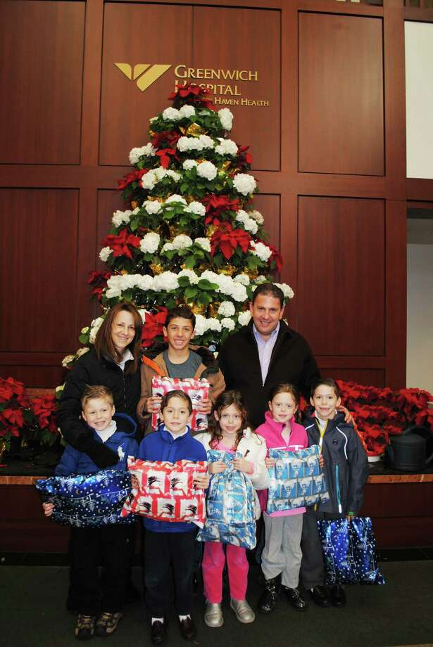 The Sernick family of Greenwich donated Pillow Pets to children spending the holidays at Greenwich Hospital. Pictured in the bottom row, from left, are Carson, 6, Cooper, 6, Katharine, 6, Chloe, 8, and Reagan, 8. In the top row from left is mom Marla Sernick, Jake, 15, and dad Keith Sernick. Photo: Contributed Photo / Greenwich Time contributed