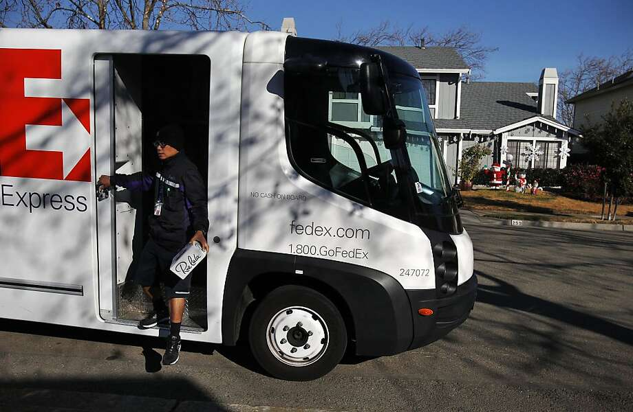 FedEx driver Ben Tilos, who works six-day weeks during the busy season, delivers a package in Alameda. Photo: Leah Millis, The Chronicle