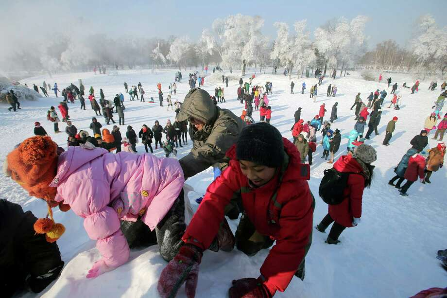 The festival also allows for some snow play. Photo: Hong Wu, Getty Images / 2013 Hong Wu