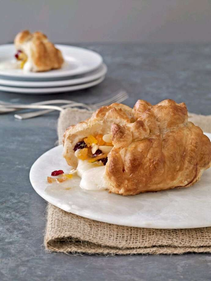 DELISH REFER. Recipe for Cranberry-Apricot Baked Brie with Honey from Country Living. NEW YEAR'S APPETIZERS Photo: Kana Okada