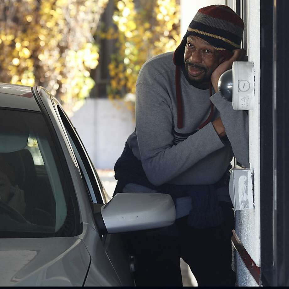 Melvin Stuart rallies for fast-food workers Friday by standing at the drive-up window at an Oakland Jack in the Box. Photo: Liz Hafalia, The Chronicle