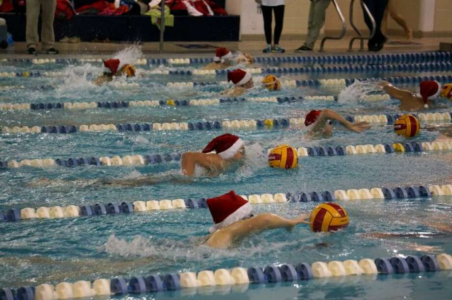 Spring Branch ISDAt a recent school board meeting, officials said this year's budget started at an $8 million deficit and a $5 million deficit is projected for next year. The funds from the increased tax rate would be used across the board.Next: School districts that passed large bonds in 2013.Pictured: The annual Holiday Swim Meet and Food Drive was held at Spring Woods High School on Dec. 11, 2013. Photo: Provided By Spring Wood High School