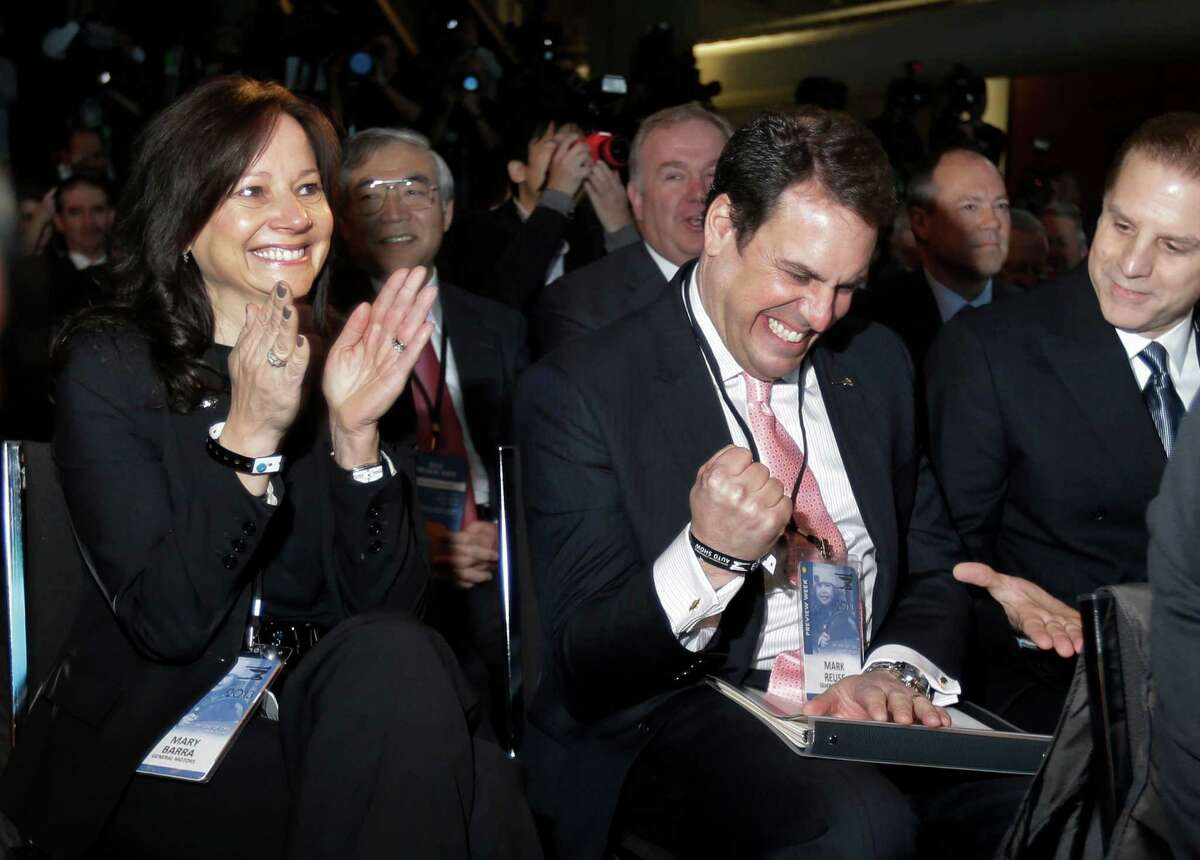 FILE - In this Monday, Jan. 14, 2013, file photo, General Motors Senior Vice President Mary Barra, left, President of North America Mark Reuss, center, and Cadillac Chief Engineer David Leone react after the Cadillac ATS is named North American Car of the Year at the North American International Auto Show in Detroit. Barra was named GM's next CEO on Tuesday, Dec. 10, 2013, making her the first woman to lead a U.S. car company. (AP Photo/Carlos Osorio, file) ORG XMIT: NY203