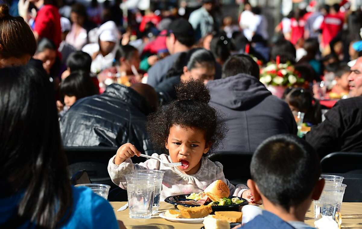 A child enjoys her Christmas Eve meal hosted by the Los Angeles Mission on December 24, 2013 along Skid Row in downtown Los Angeles, California. The LA Mission was established in 1936 as a soup kitchen and Christian outreach to the homeless and today, with the help of many volunteers, a Christmas celebration was made possible for the impoverished and marginalized members of society. AFP PHOTO / Frederic J. BrownFREDERIC J. BROWN/AFP/Getty Images