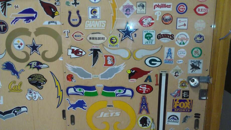 Decals in the visitors locker room, from all the teams that have been through here for baseball and football. The Chronicle/Sam Whiting