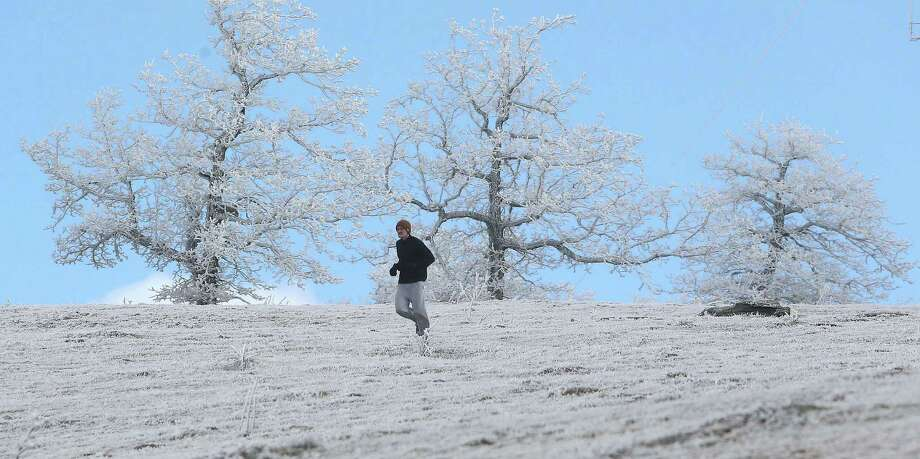 Even south of the power outages, winter was making its presence felt. In North Carolina, Mark Brown runs through the ice on top of Bearwallow Mountain. Photo: Photos By Mike Dirks / Associated Press / Times-News