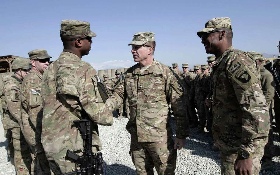 U.S. Maj. Gen. James C. McConville (center) visits U.S. troops in Jalalabad,  east of Kabul on Christmas Eve. Photo: Rahmat Gul / Associated Press / AP